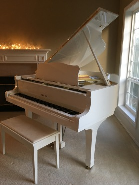White Yamaha Grand Piano