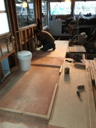 "Laying down 3/4"" marine grade plywood for our floor"