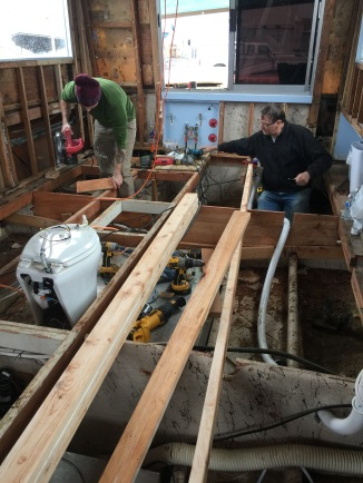 Rebuilding wooden hual and resupporting the sringers