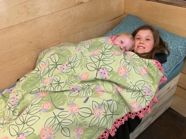 Joy (10) snuggles with Felicity (6)
