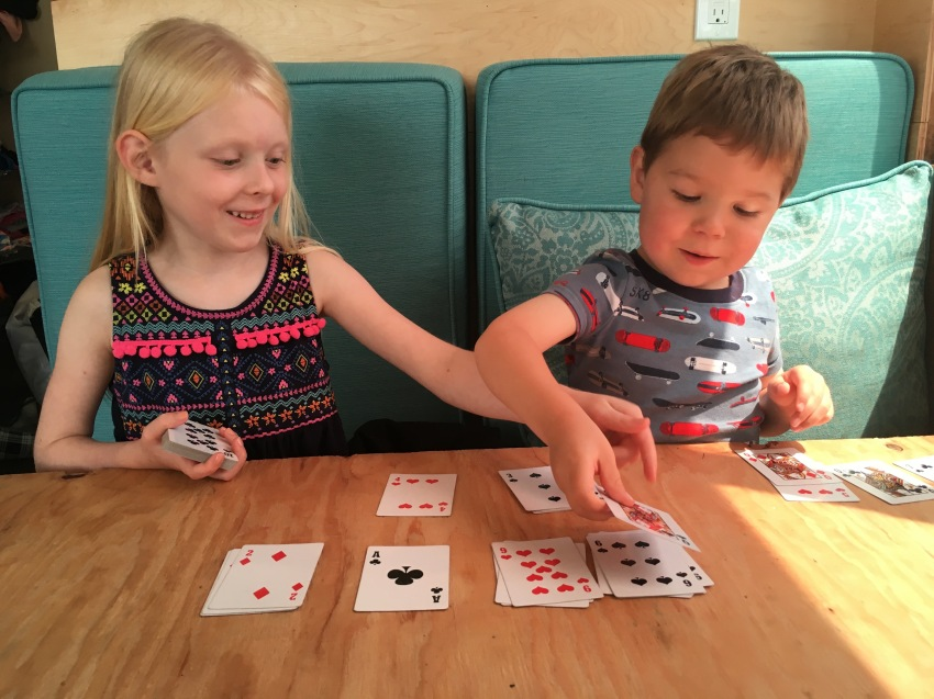 Matching playing cards by suit in numerical order.