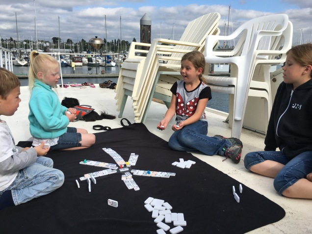 Family game of Mexican Train on our top deck