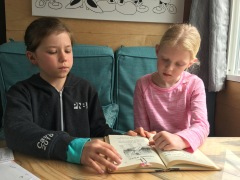 Big sister helping with reading